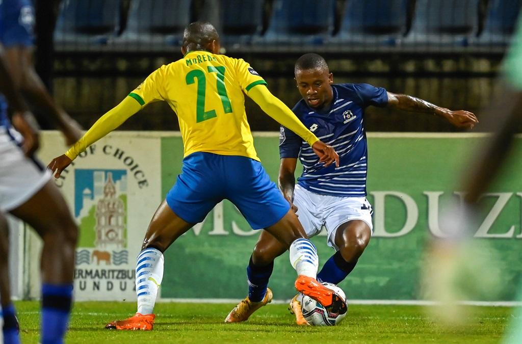 Thapelo Morena of Mamelodi Sundowns FC challenges Thabiso Kutumela of Maritzburg United during the DStv Premiership match between Maritzburg United and Mamelodi Sundowns at Harry Gwalla Stadium on December 05, 2020 in Pietermaritzburg.