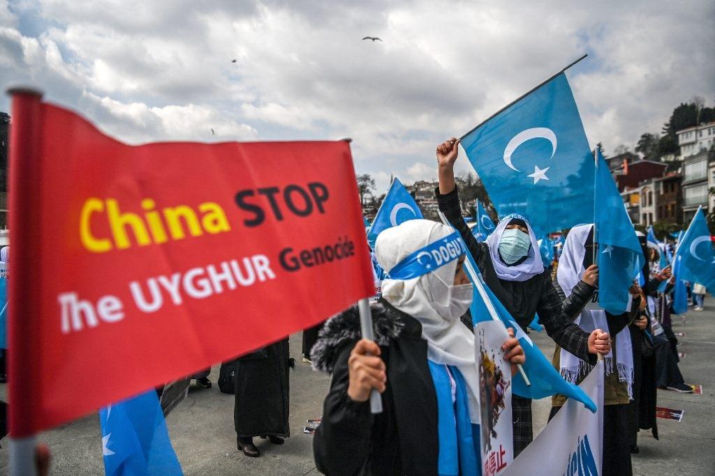 Muslim Uighur minority women in Turkey hold placar
