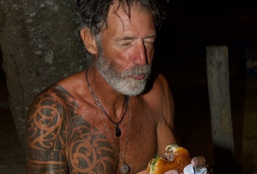 Zirk Botha enjoying a burger in Buzios after completing a 7200km solo transatlantic row from Cape Town to Rio.