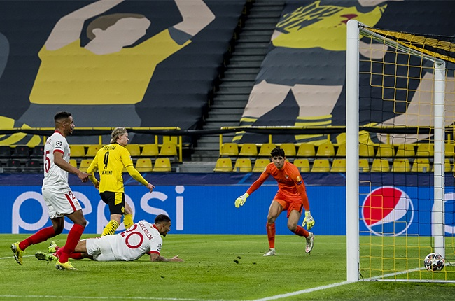 Erling Haaland of Borussia Dortmund scores the opening goal during the Champions League match between Borussia Dortmund and Sevilla.