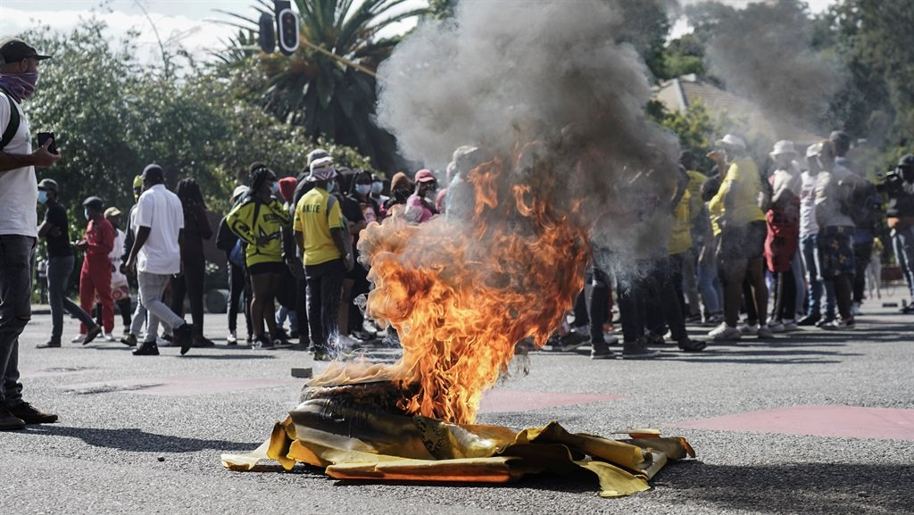 A tire burns on Empire street amid student protest