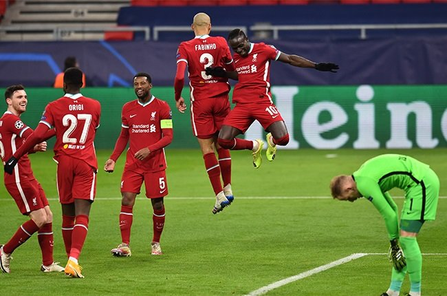 Sadio Mane of Liverpool celebrates  after scoring the second goal during the UEFA Champions League Round of 16 match between Liverpool FC and RB Leipzig.