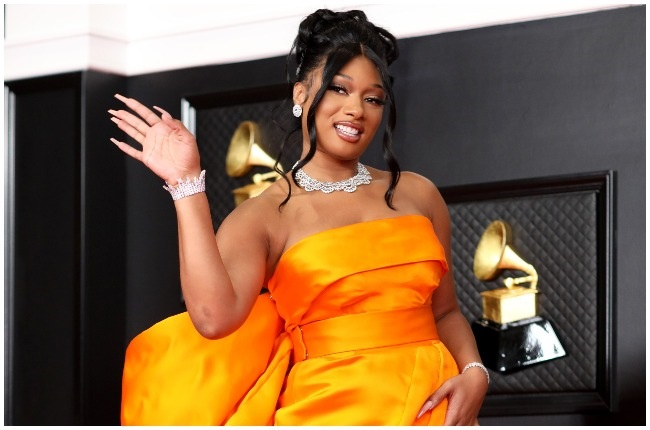 Megan thee stallion looked stunning in this orange Dolce and Gabbana dress.