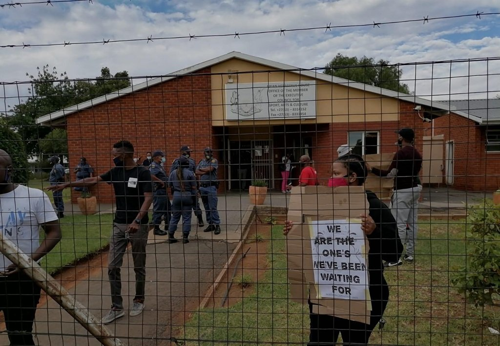 Artists encounter the South African Police Service outside MEC Desery Finie's office. (Facebook)