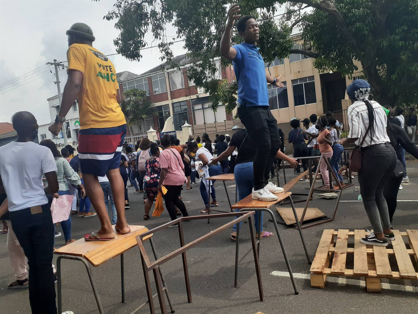 Students blocked off Dunkirk Road in Umbilo, Durban with desks and chairs.