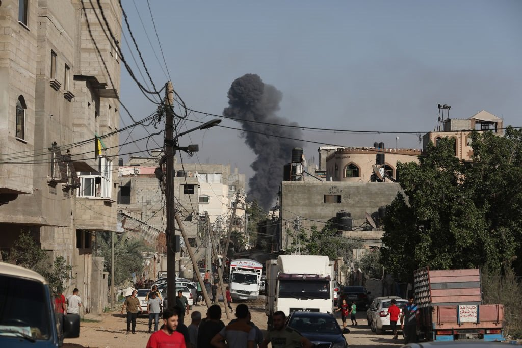 Smokes rise from buildings as Israeli fighter jets continue to pound Palestinian homes and agricultural lands in the Gaza Strip.