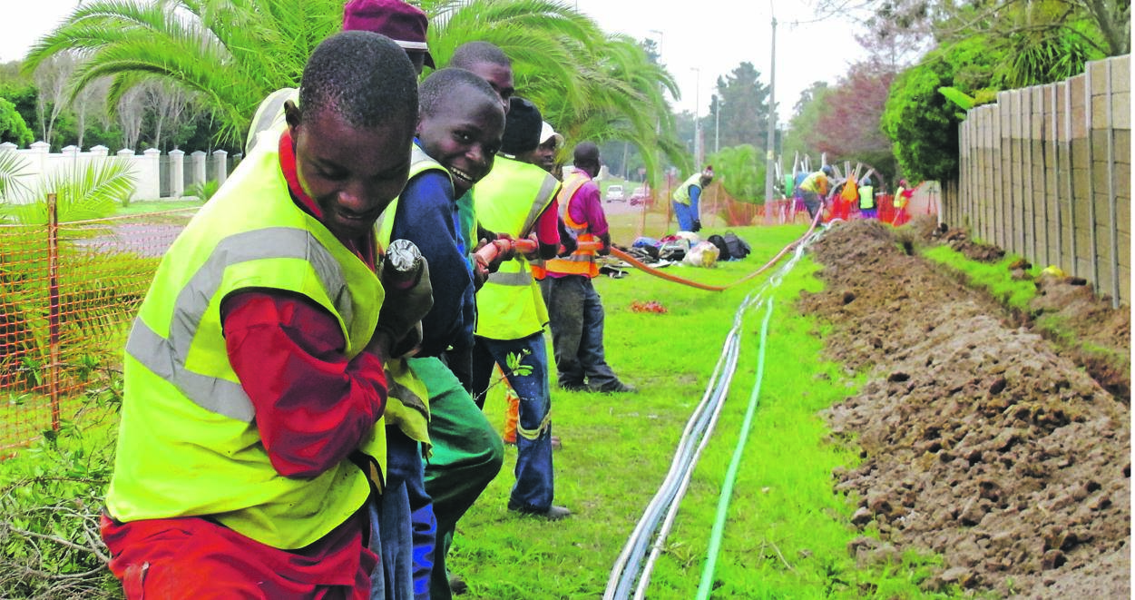Workers lay fibre optic cables for Wi-Fi internet connections. South Africa's poor internet access is set to persist now that the spectrum allocation has been delayed again