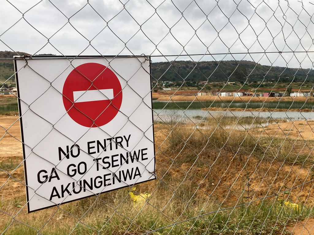 The fence at the water-filled quarry near Mamalodi in Pretoria where two minor boys drowned.