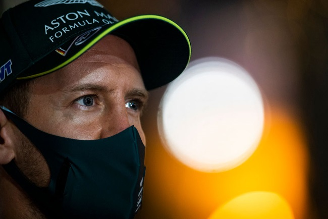 Sebastian Vettel of Germany and Aston Martin F1 Team looks on in the Paddock  during previews ahead of the F1 Grand Prix of Bahrain at Bahrain International Circuit on March 25, 2021 in Bahrain, Bahrain.