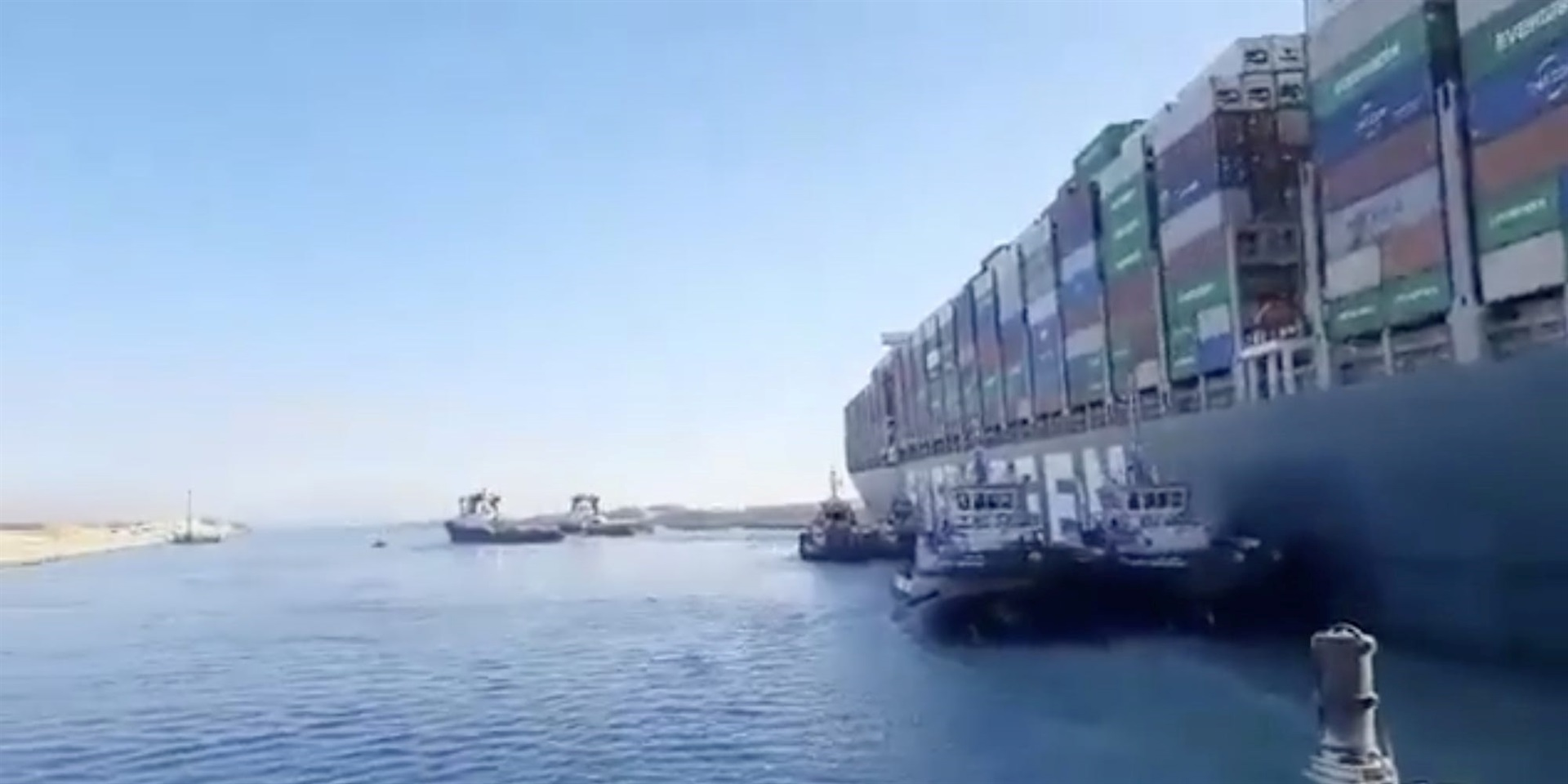 A March 29 video still of the Suez Canal, which the Ever Given (right) had blocked.