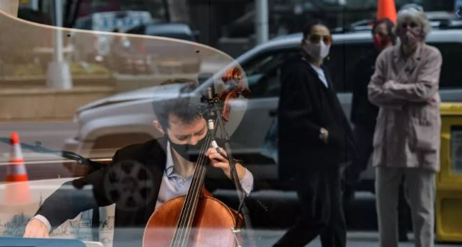 Musicians Michael Katz, on cello, and pianist Spencer Myer perform at a storefront series highlighting musicians after a devastating year for entertainment Angela Weiss AFP/File