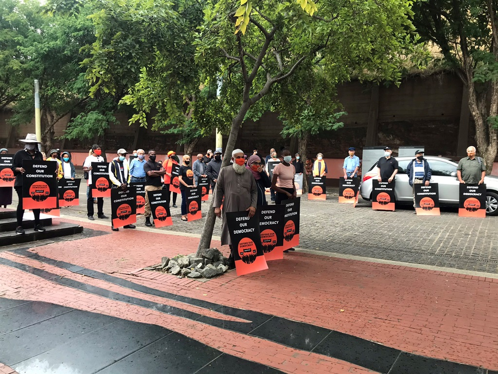 Supporters of Defend Our Democracy stage a picket in front of the Constitutional Court.