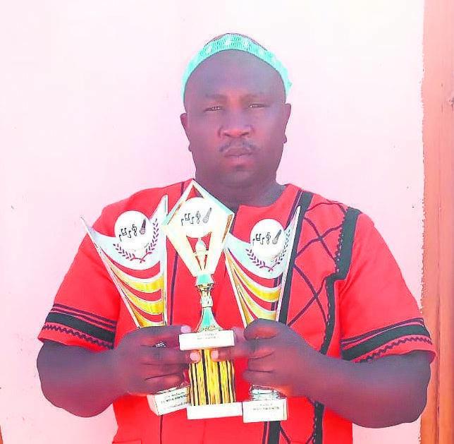 """Landile """"Xhentsakumisiwe"""" Sokweba with all three of his awards."""