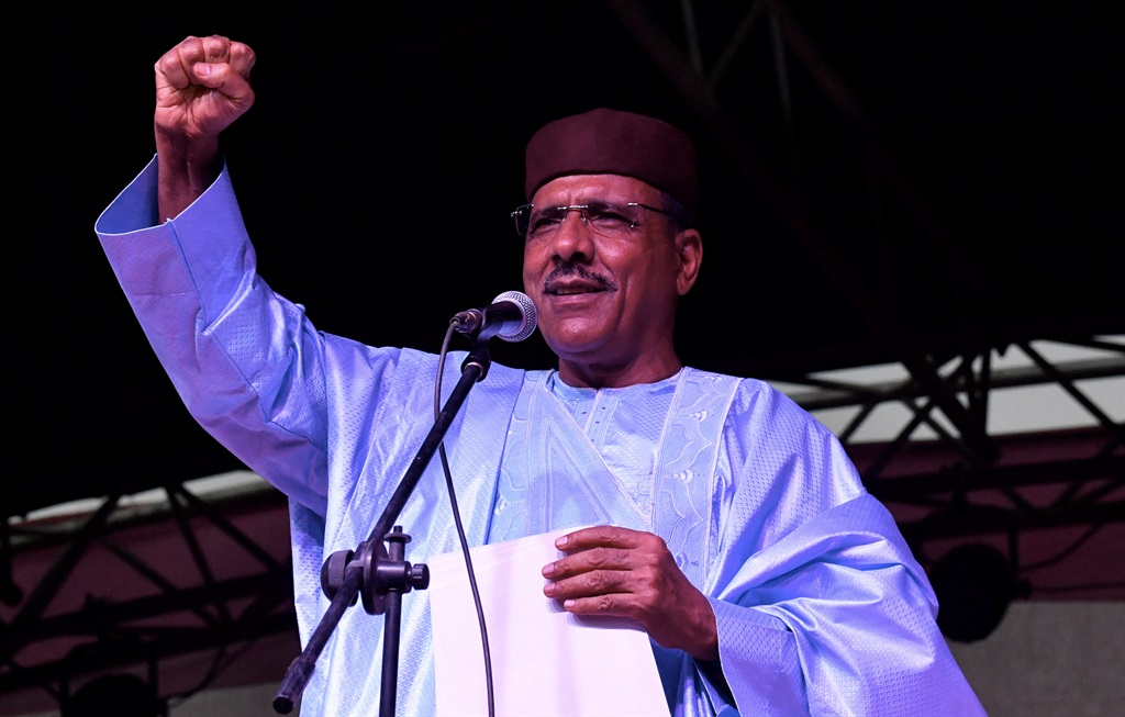Niger's newly elected president Mohamed Bazoum gestures as he delivers a speech at his party headquarter after the announcement of his election in Niamey, on 23 February, 2021.