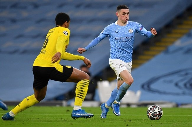 Phil Foden was Manchester City's hero. (Photo by Paul ELLIS / AFP)
