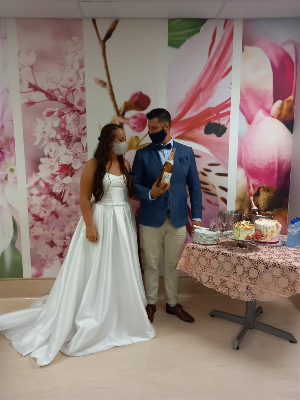 Couple embracing during wedding ceremony at Melome