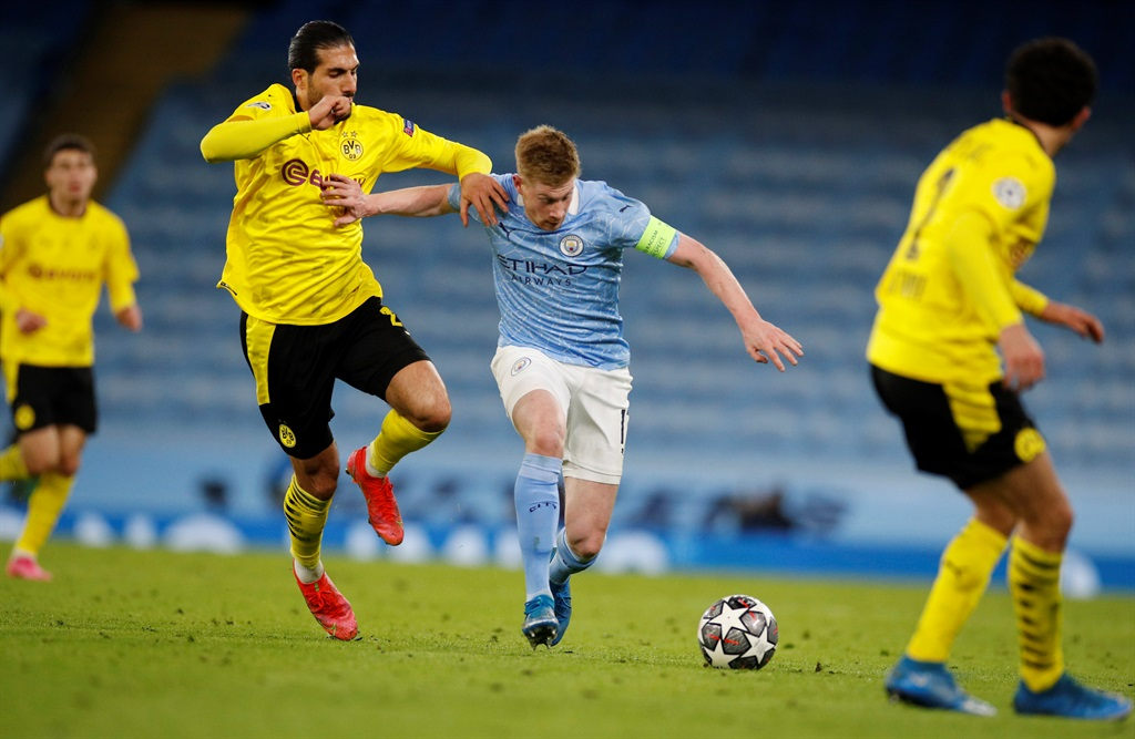 Manchester City's Kevin De Bruyne in action with Borussia Dortmund's Emre Can. Picture: Phil Noble/Reuters