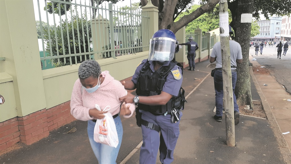 A student is arrested by police during student protests at the Durban University of Technology.