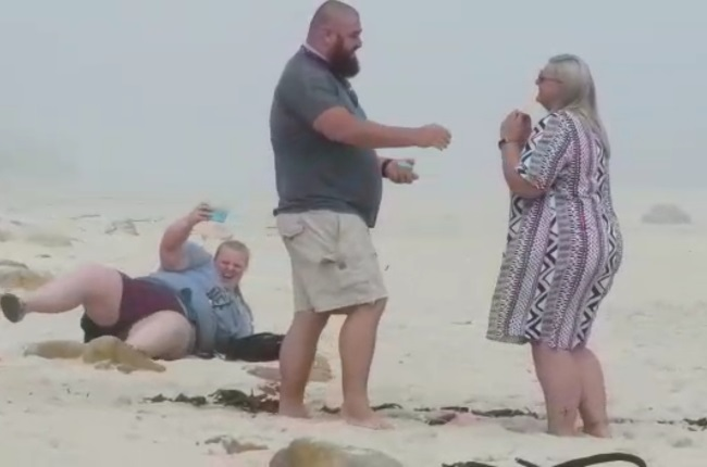 Ian Share proposes to Megan Edwards while Celine falls in the background. (Photo: Supplied)
