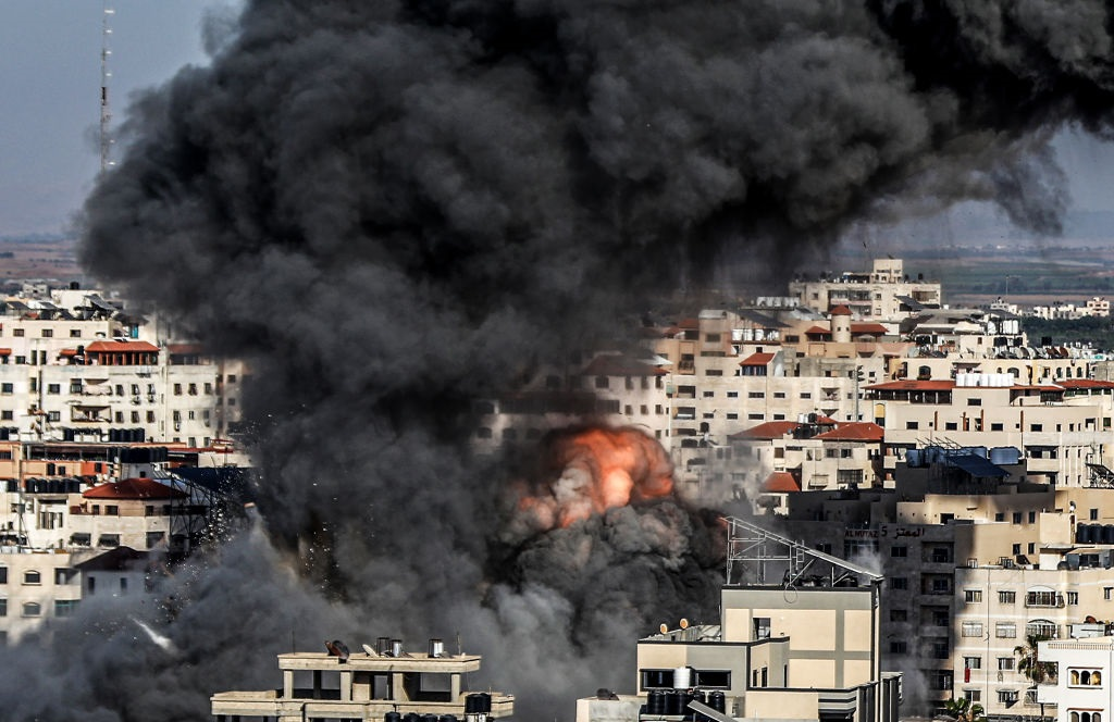 Smoke and flame rise after an attack over a building carried out by Israeli army, in Gaza City.
