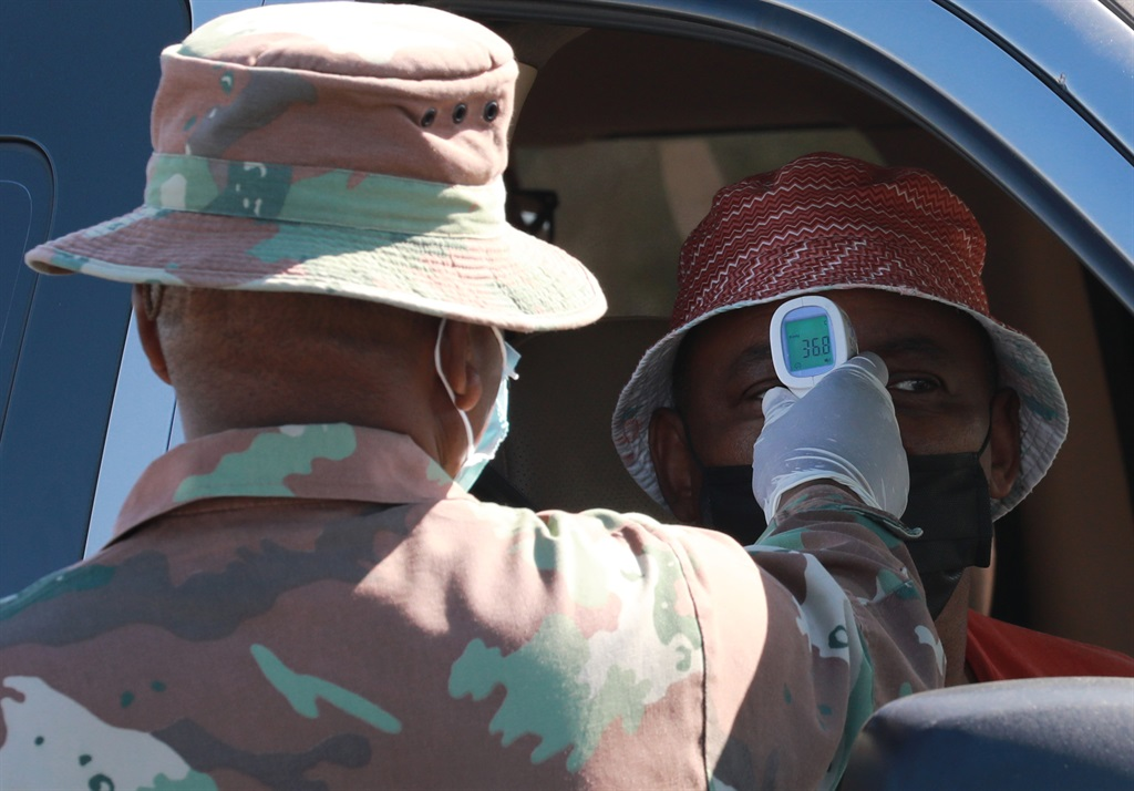 A South African Defence Force medic checks the temperature of a motorist with a thermometer at a roadblock on April 26, 2020 in Cape Town, South Africa. Photo: Nardus Engelbrecht/Gallo Images