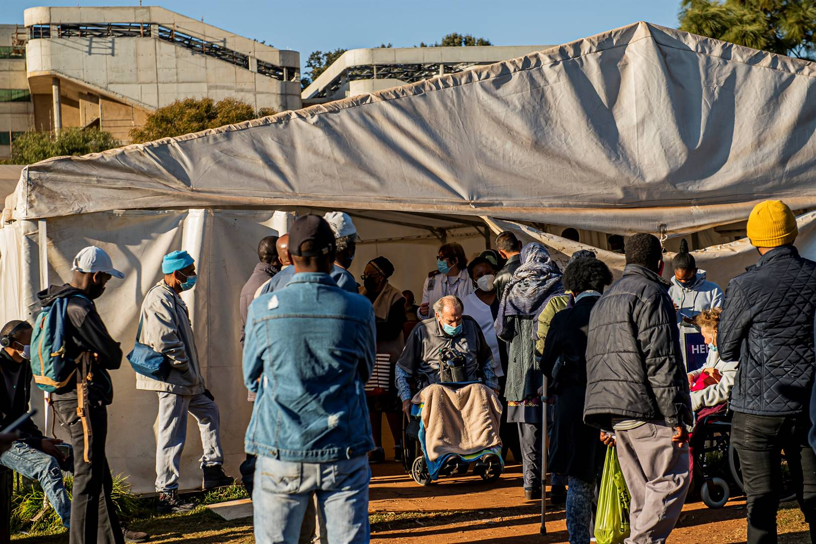 Patients being monitored for Covid-19 symptoms in a dusty tent next to the Helen Joseph State Hospital in Johannesburg before being allowed to enter the hospital. Photo: Deon Raath