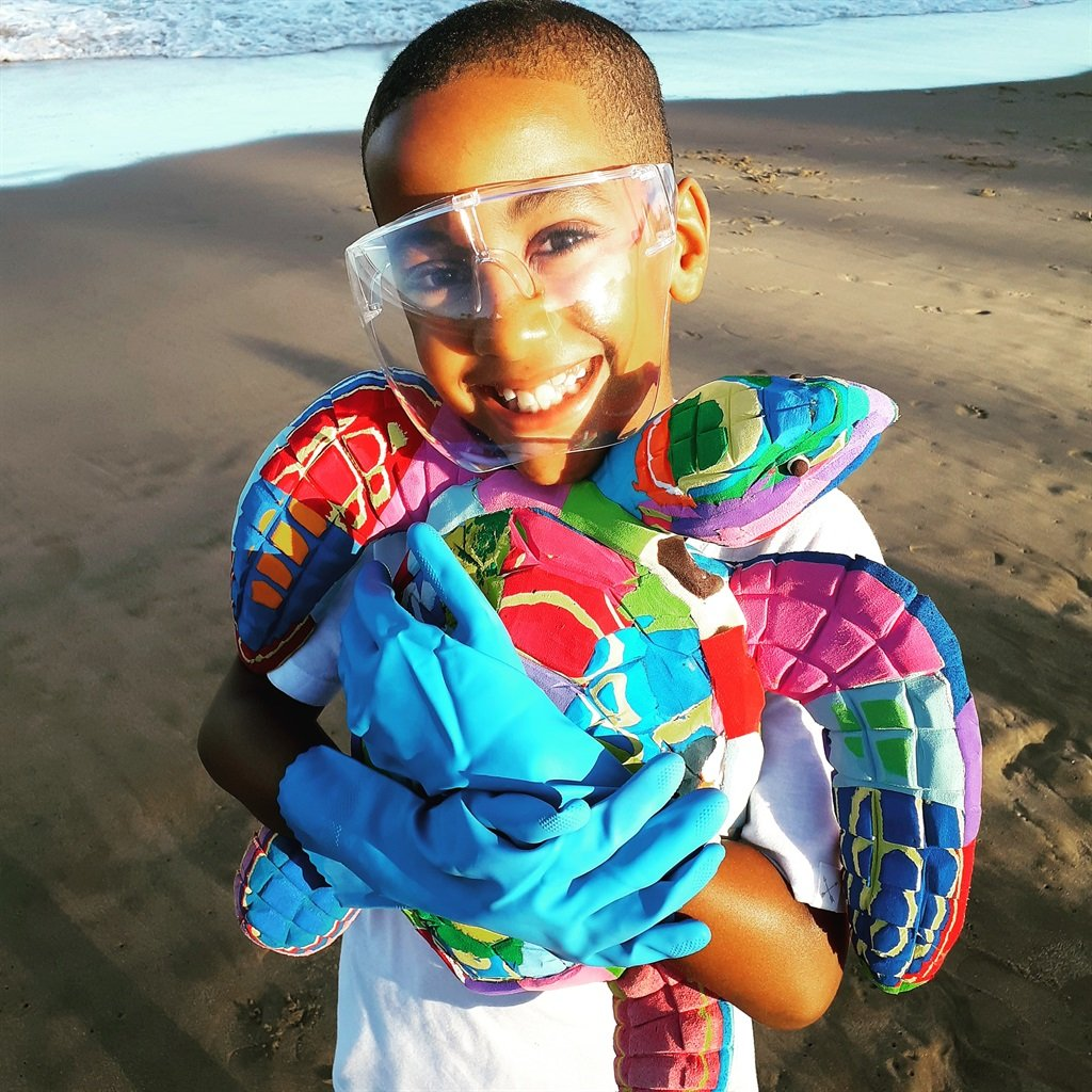 Romario Valentine during one of his beach clean up
