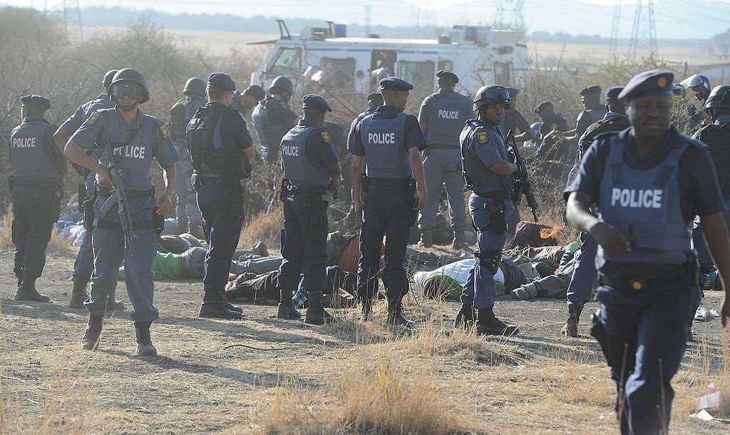 Police officers open fire on striking mine workers
