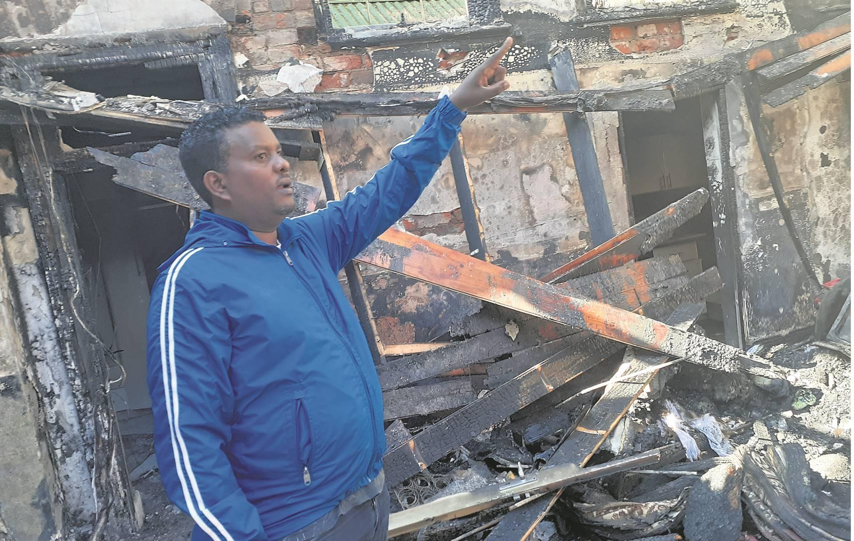 Serawit Demelew, secretary of Debre Bisrat St Gabriel Ethiopian Orthodox Church in Durban, surveys what is left of the building after it burnt down.