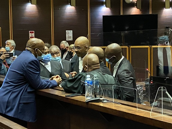<em>Former president Jacob Zuma talks to his counsel at the Pietermaritzburg High Court on 26 May 2021. (Photo: Karyn Maughan/News24)</em>