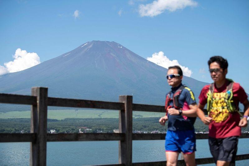 The active volcano's symmetrical slopes were close