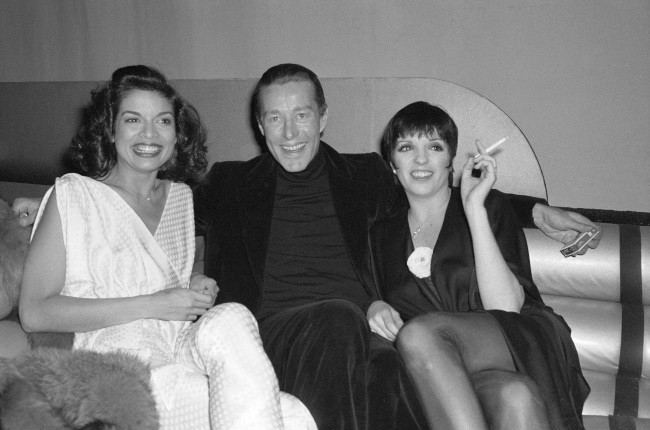 """Actress Liza Minnelli (right) currently on Broadway in musical entitled """"The Act,"""" at the Majestic Theatre, relaxes at Studio 54 with fashion designer Halston and Bianca Jagger as she gears up to celebrate her 32nd birthday with a party that will be thrown 3/12/78 at Halston midtown showroom."""