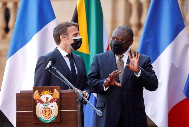 South Africas President Cyril Ramaphosa (R) talks