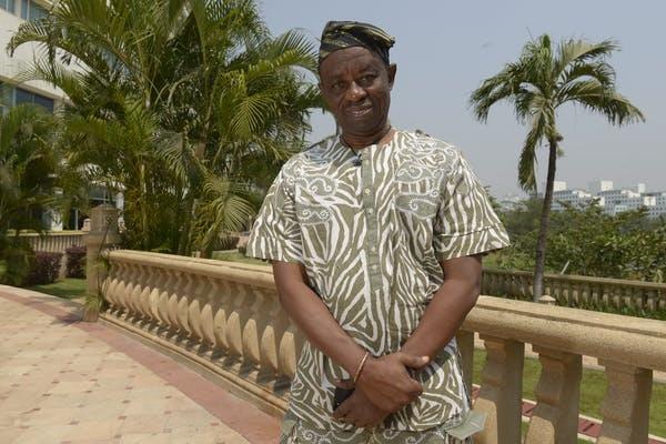 Veteran Nigerian filmmaker, Tunde Kelani poses for