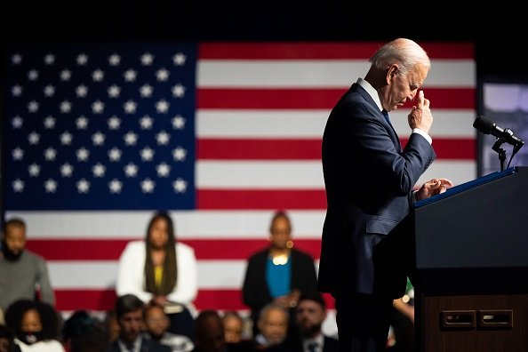 U.S. President Joe Biden silently prays during a moment of silence during commemorations of the 100th anniversary of the Tulsa Race Massacre on 1 June, 2021 in Tulsa, Oklahoma. (Photo by Brandon Bell/Getty Images)