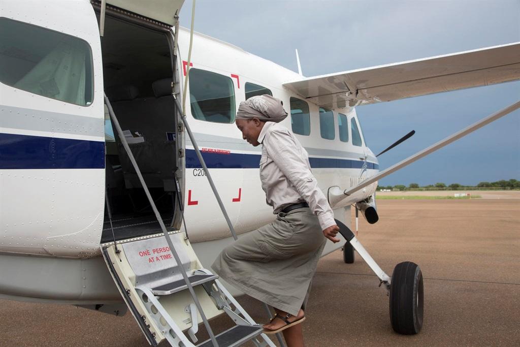 Employee getting on plane