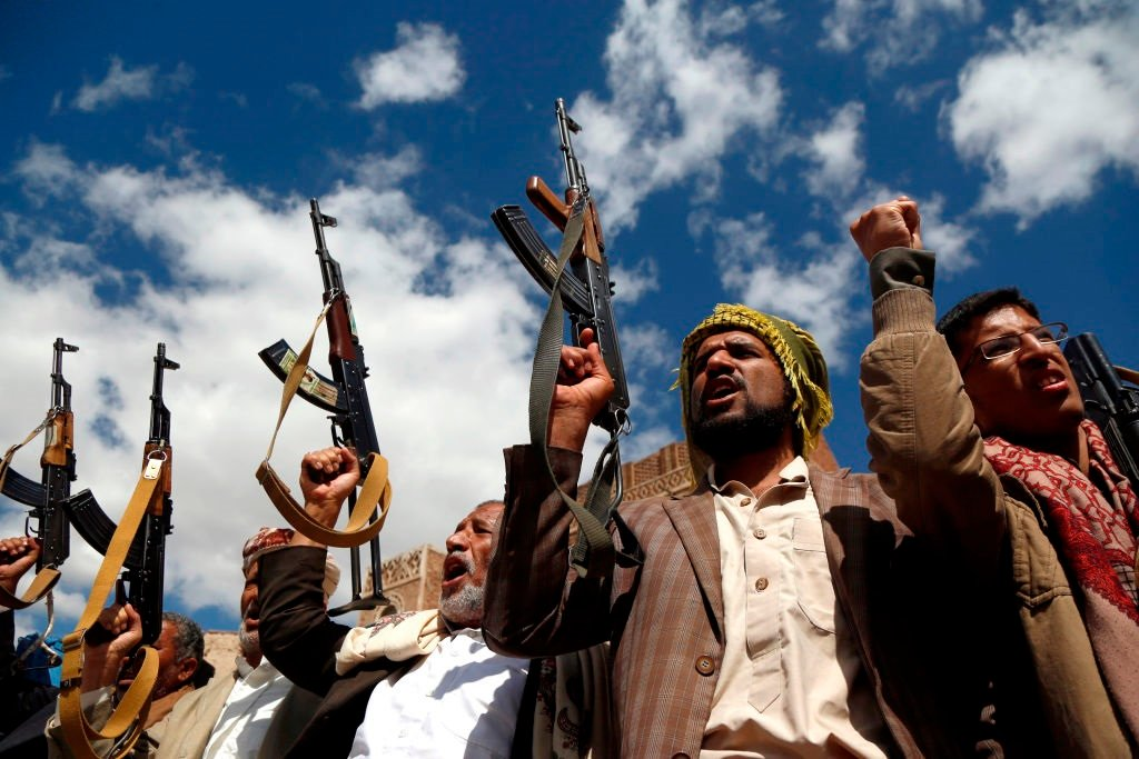Houthi followers hold their guns during a tribal gathering against the continued war and blockade in Sanaa, Yemen, in 2019.