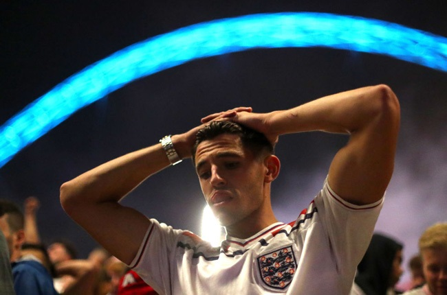 An England fan reacts after the UEFA Euro 2020 Championship Final between Italy and England at Wembley Stadium (Getty Images)