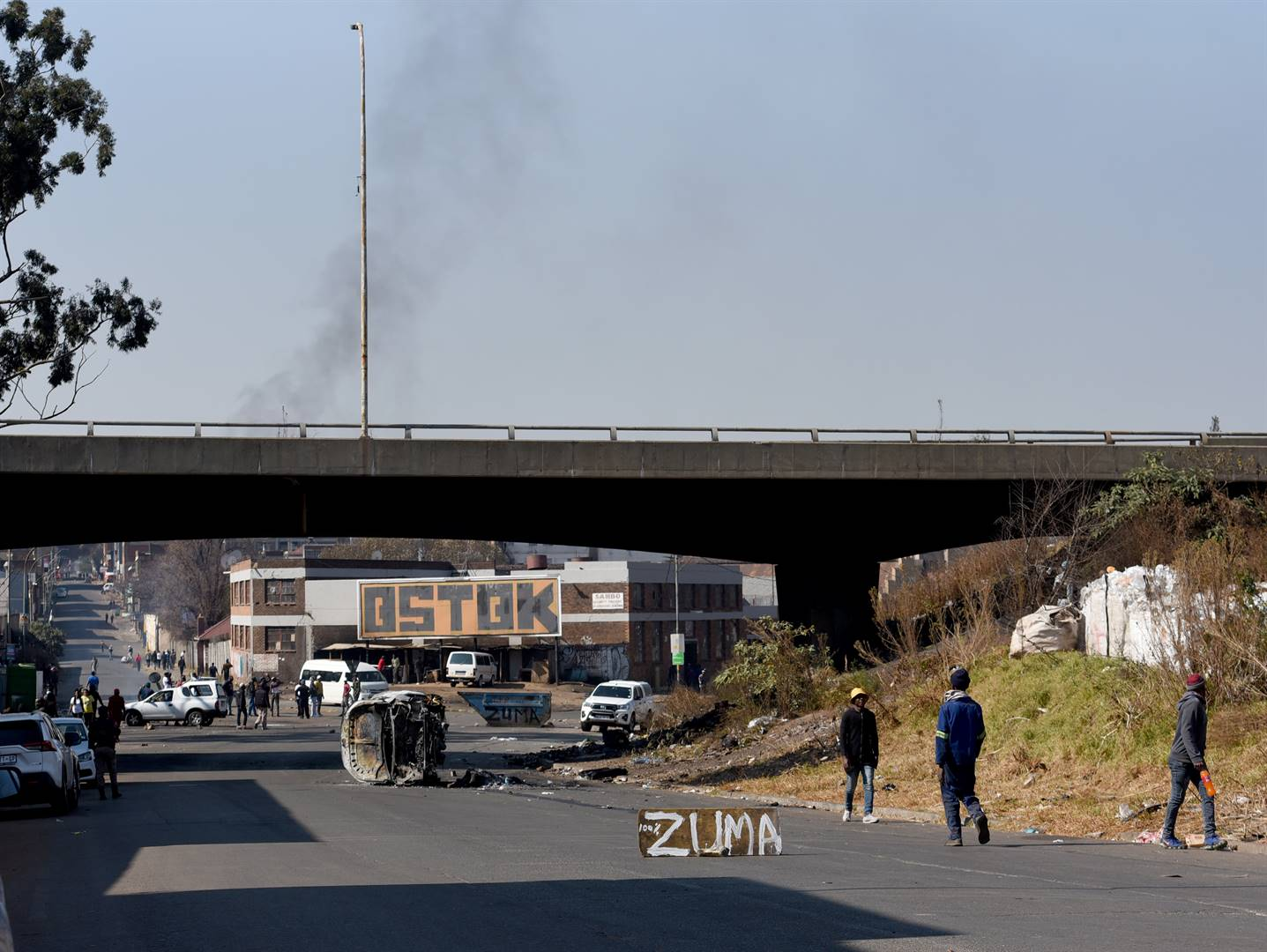 The smouldering remains of property that was destroyed during pro-Zuma protests in Johannesburg on Sunday PHOTO: Tebogo Letsie/City Press