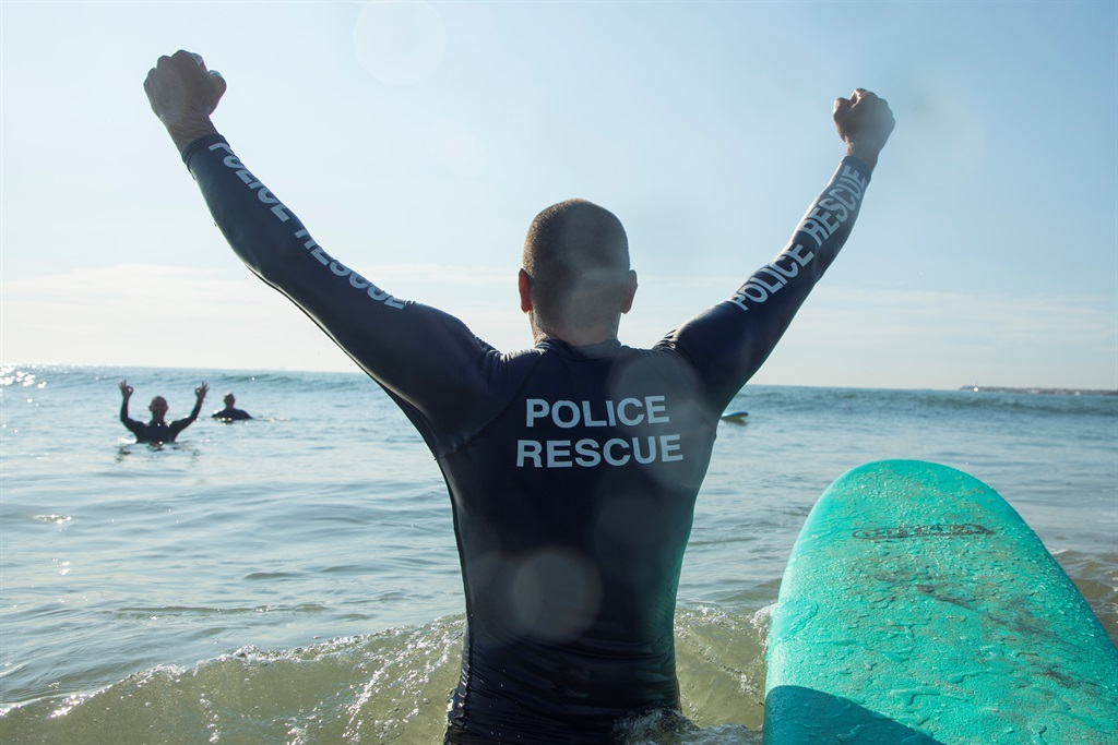Some metro cops received a surf lesson on Thursday in Durban.