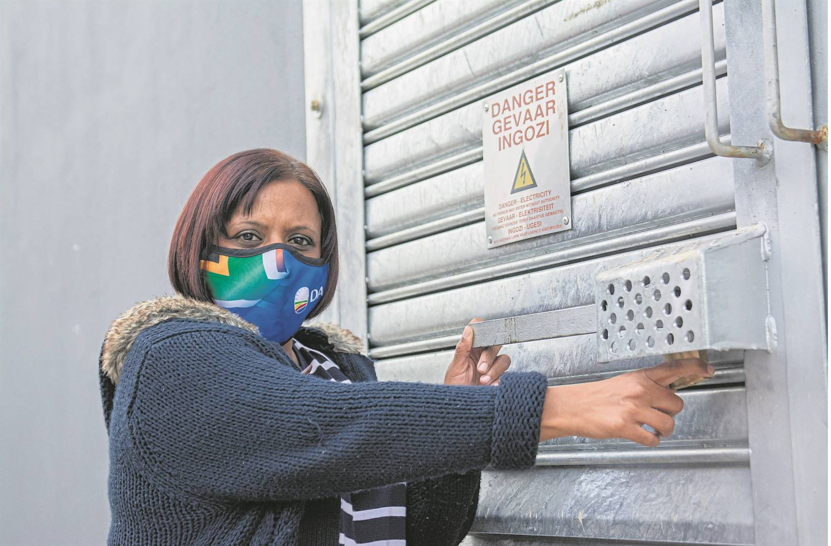 Ward 33 councillor Suraya Reddy at the Woodburn substation, where a local business has replaced missing locks to secure the equipment inside.