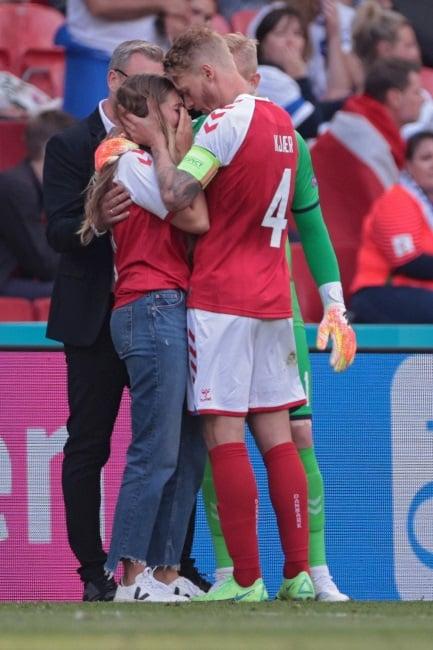 Danish captain Simon Kjaer comforts Sabrina Kvist Jensen, the partner of Christian Eriksen, after the footballer collapsed on the pitch. (Photo: Gallo Images/ Getty Images)