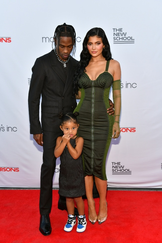 Travis and Kylie attended the benefit with three-y