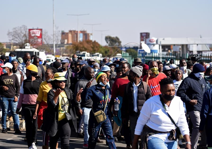 Disgruntled Soweto residents participate in a marc