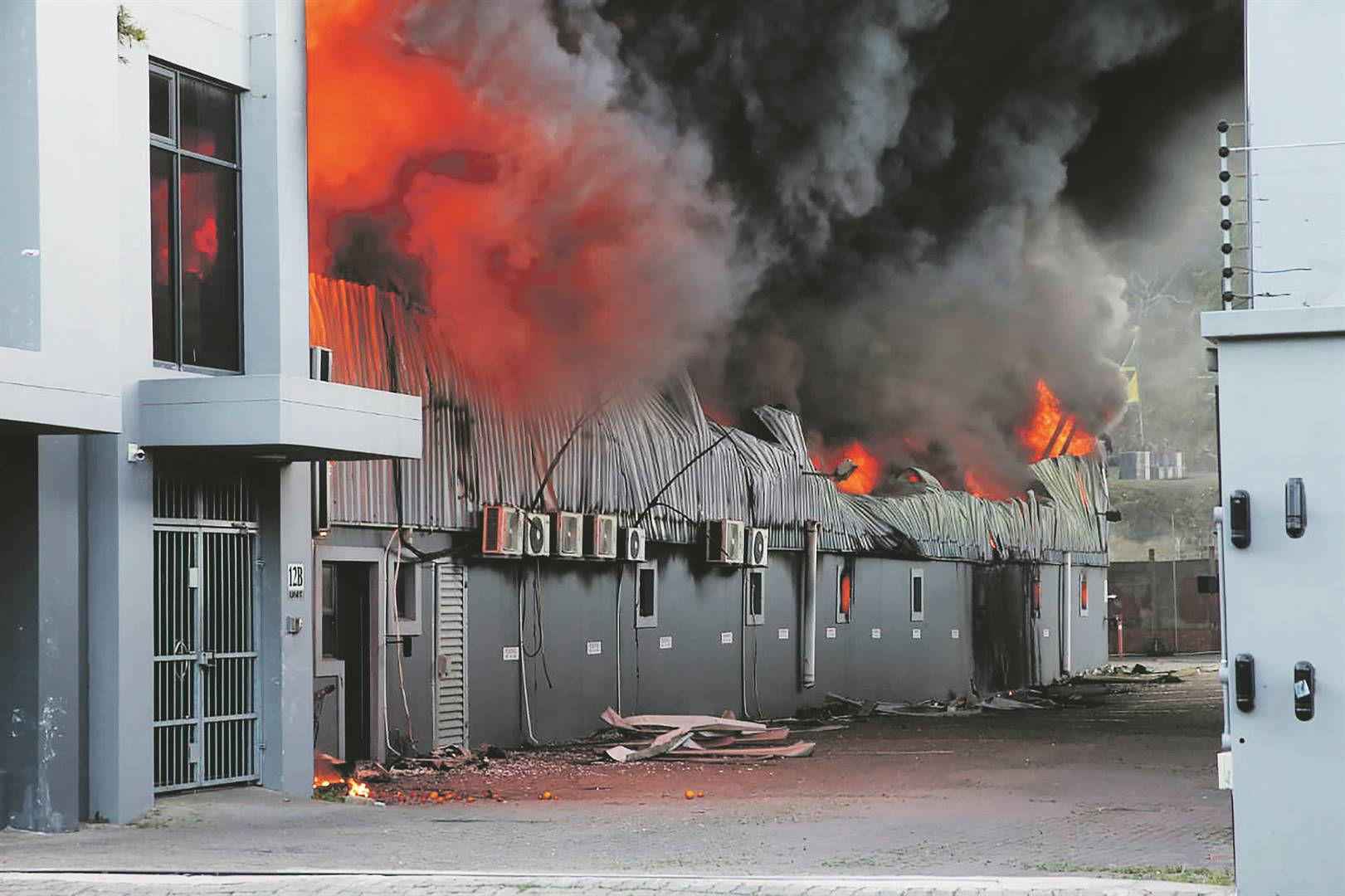 A factory burns on the outskirts of Durban on Wednesday during the riots. Photo: AP