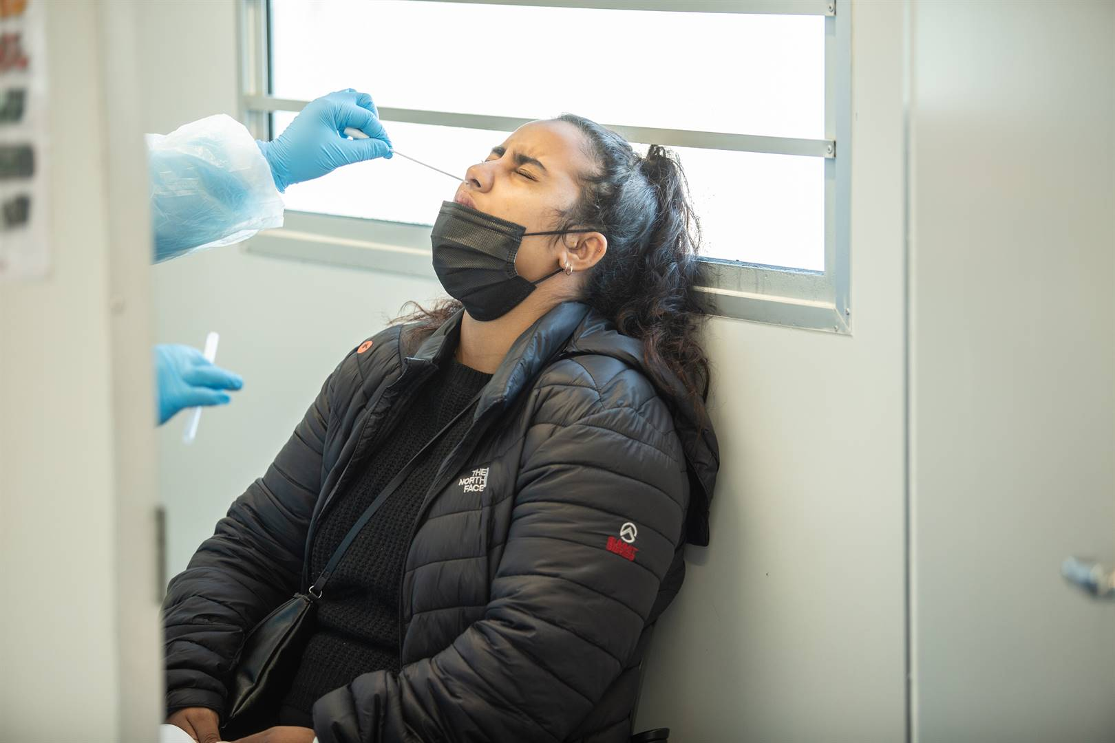 A woman takes a Covid-19 test at Bothasig Community Day Centre in Cape Town. South Africa is currently experiencing the third wave of the Covid-19 pandemic. Photo: Misha Jordaan/Gallo Images