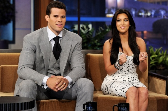 NBA player Kris Humphries (L) and his wife reality TV personality Kim Kardashian appear on the Tonight Show With Jay Leno at NBC Studios. Photographed by Kevin Winter