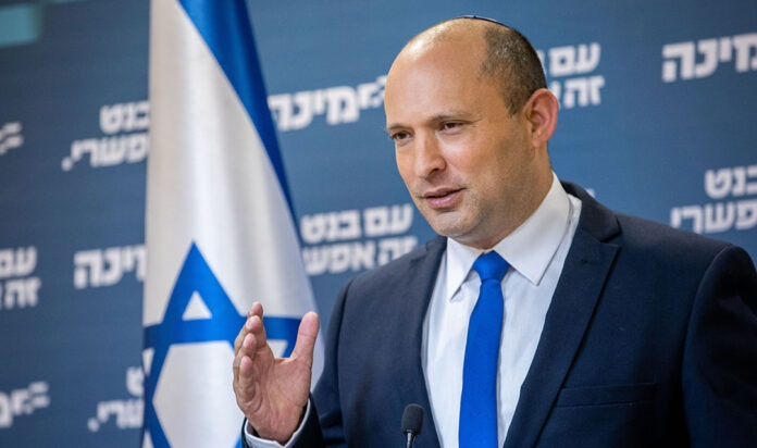 Naftali Bennett gives a press conference at the Kn