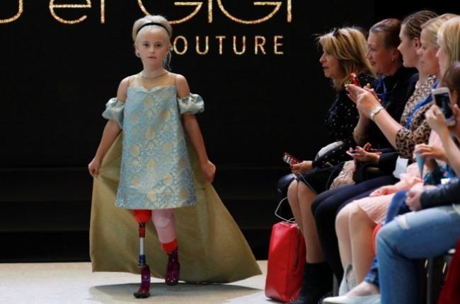 Daisy-May Demetre walks the runway at Paris Fashion Week. (PHOTO: Reuters)