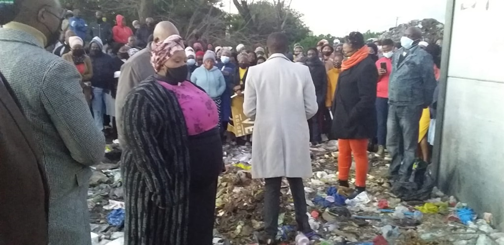A candlelight vigil was held on Monday at the site where Siphokazi Booi's burnt body was found.